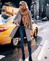 scarf,black boots,skinny jeans,grey coat,shoulder bag,black sweater,black sunglasses