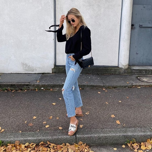 jeans ripped jeans high waisted jeans slide shoes black top black bag