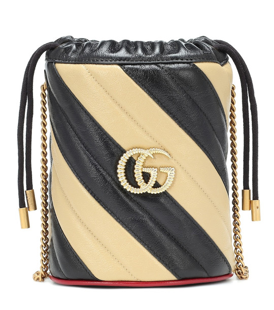 Gucci GG striped leather bucket bag in beige