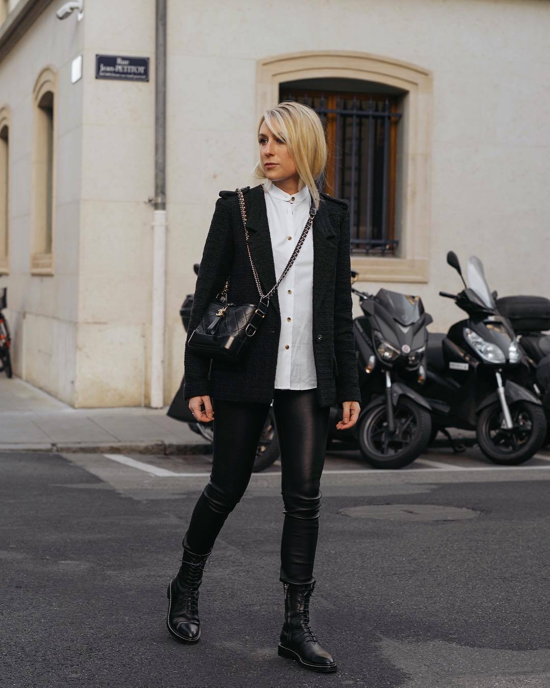 pants black leggings black boots lace up boots black blazer white shirt black bag chanel bag crossbody bag
