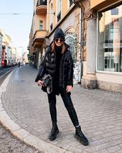 jacket,black jacket,puffer jacket,black boots,ankle boots,DrMartens,black leather pants,skinny pants,black sweater,turtleneck sweater,dior bag,grey beanie,sunglasses