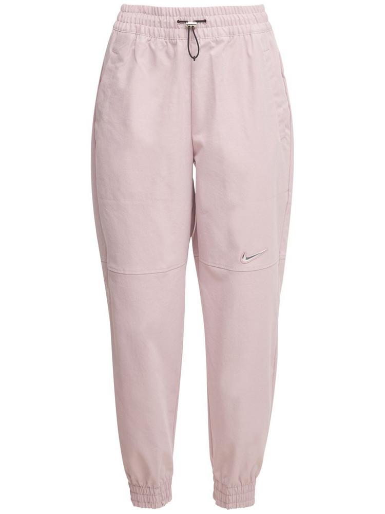 NIKE Swoosh Woven Tech Pants in grey / pink