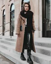 shoes,black boots,DrMartens,black vinyl pants,long coat,camel coat,scarf,mini bag,white sweater