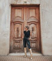 shoes,knee high boots,gold,black pants,tank top,black top