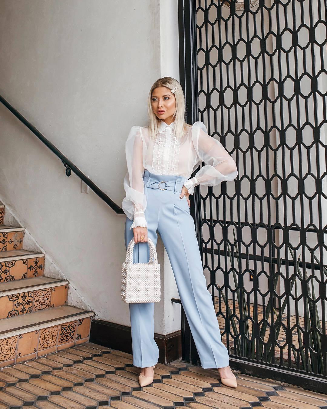 top white shirt pumps high waisted pants blue pants pleated white bag handbag