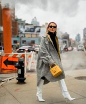 bag,boxed bag,handbag,yellow bag,knee high boots,white boots,heel boots,oversized coat,grey coat,black sweater,turtleneck sweater,black pants,black sunglasses