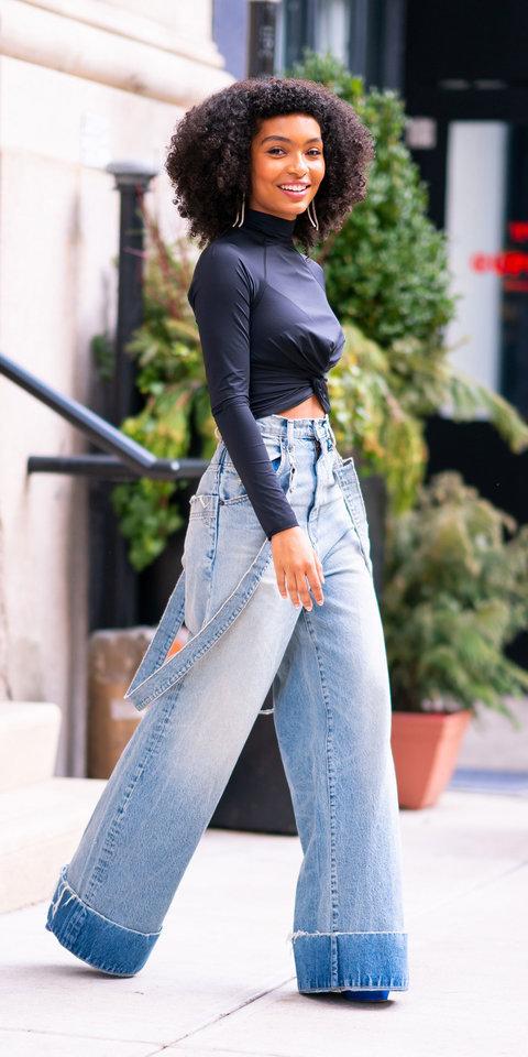 top turtleneck black black top yara shahidi celebrity denim jeans wide leg jeans fall outfits pants grown-ish bell bottoms