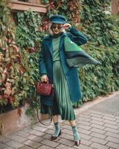 skirt,midi skirt,green skirt,pumps,socks,brown bag,turtleneck sweater,pleated skirt,green coat,scarf,beret