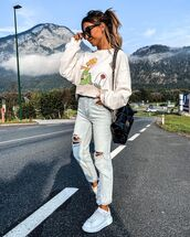 jeans,ripped jeans,white sneakers,sweatshirt,chanel bag,black bag