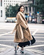 coat,faux fur coat,sneakers,black skirt,maxi skirt,streetstyle,winter coat