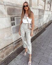 pants,cargo pants,leather,white sandals,white top,crop tops,prada bag