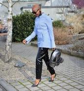 pants,black vinyl pants,pumps,backpack,blue shirt