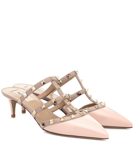 Valentino Garavani Rockstud patent leather mules in pink