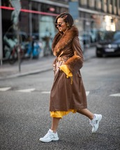 coat,brown coat,leather,white sneakers,long coat,yellow dress,long sleeve dress