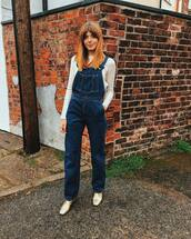 jumpsuit,denim jumpsuit,dungarees,gold shoes,white top,long sleeves,streetstyle