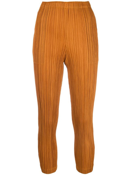 Pleats Please Issey Miyake cropped pleated trousers in orange
