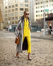 jacket,blazer,oversized,yellow,straight pants,yellow pants,pumps,brown bag,handbag,long coat,black and white,stripes,faux fur coat,turtleneck sweater