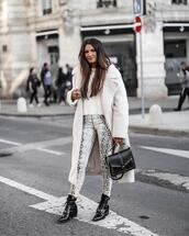 pants,snake print pants,black boots,ankle boots,patent boots,black bag,long coat,white sweater,teddy bear coat