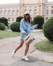 top,oversized shirt,denim shorts,white sneakers,cap,bag