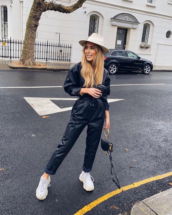 jumpsuit long sleeves leather white sneakers black bag hat black jumpsuit