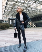 jacket,black leather jacket,acne studios,black boots,ankle boots,black leggings,bucket bag,black bag,black leather skirt,mini skirt,shirt,stripes