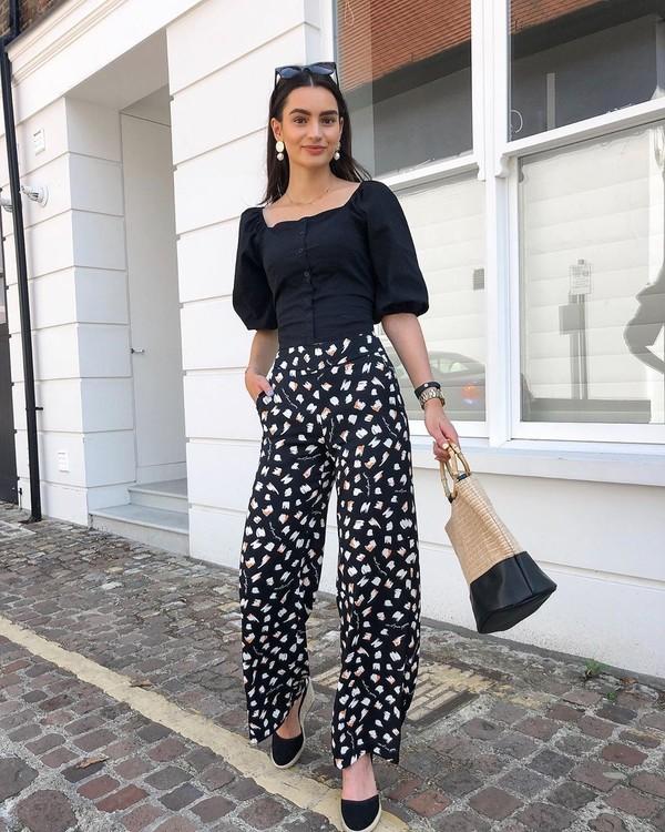 pants wide-leg pants black pants floral pants platform shoes handbag black blouse