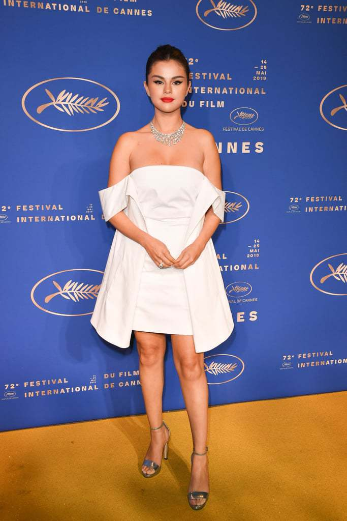 shoes Silver sandals selena gomez celebrity off the shoulder off the shoulder dress white white dress cannes