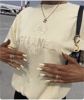t-shirt,chanel t-shirt,looking for this yellow chanel shirirt,sweater,chanel,chanel sweater,cream,nails,winter outfits,shirt