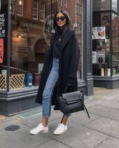 coat,black coat,long coat,wool coat,white sneakers,black bag,high waisted jeans,turtleneck sweater,black sweater