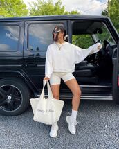 sweater,white hoodie,black and white shorts,sneakers,socks,white bag