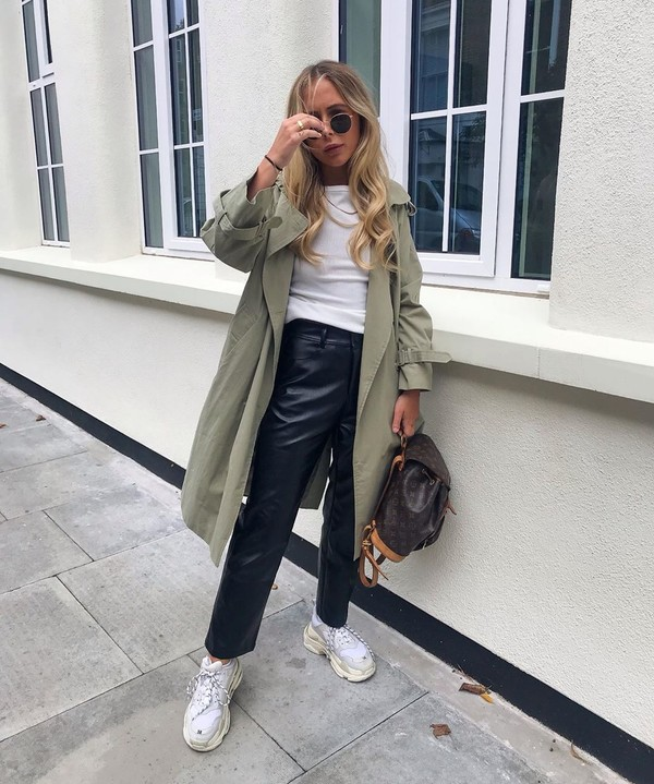 pants black leather pants sneakers trench coat louis vuitton bag white t-shirt