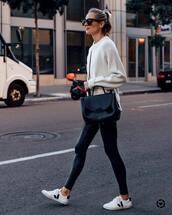 pants,black leggings,white sneakers,black bag,crossbody bag,white sweater,knitted sweater,black sunglasses,streetstyle