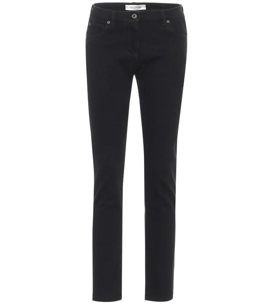 Valentino Mid-rise skinny jeans in black