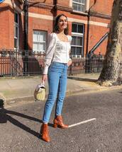 top,white top,long sleeves,skinny jeans,high waisted jeans,brown boots,ankle boots,handbag