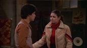 coat,black,tan,mila kunis,that 70s show,puffer jacket,winter coat,red