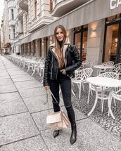 jacket,aviator jacket,black boots,ankle boots,black skinny jeans,black ripped jeans,shoulder bag