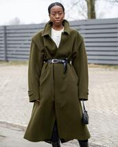 coat,green coat,oversized coat,long coat,black bag,mango,mini bag,shoulder bag,black boots,knee high boots,tights,plaid skirt,black belt,white sweater