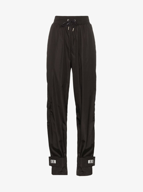 Off-White high waisted logo patch track pants in black
