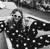 jumpsuit,star onesie,stars,pajamas,iris apatow,black jumpsuit,onesie,black onesie,white and black onesie