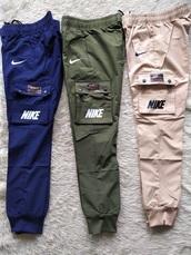 pants,nike green,nike,green,beige,blue,nike pants,trackpants,joggers,woven,nike air,nike sportswear,nike air force 1