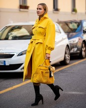 coat,long coat,yellow coat,yellow bag,black boots,knee high boots