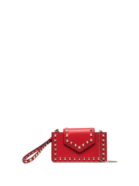 Valentino Garavani Rockstud-embellished clutch bag in red