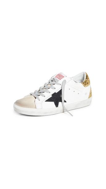Golden Goose Superstar Sneakers in black / gold / white