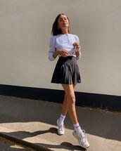 skirt,mini skirt,pleated skirt,sneakers,socks,white cardigan