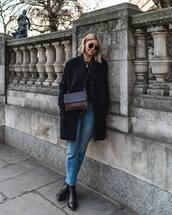 coat,black coat,black boots,straight jeans,brown bag,black top