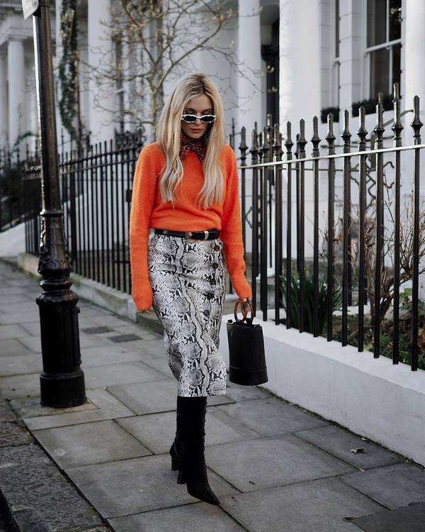 skirt midi skirt snake print slit skirt knee high boots black boots heel boots black bag handbag black belt orange sweater scarf