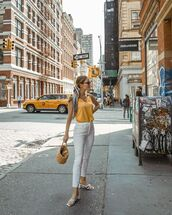 top,yellow top,tank top,white jeans,high waisted jeans,white sandals,bag,bucket bag,scarf