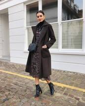 dress,midi dress,wrap dress,tiger print,black boots,ankle boots,heel boots,patent shoes,brown coat,black turtleneck top,black bag