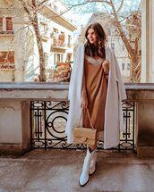 coat,wool coat,long coat,white coat,white boots,cowboy boots,chanel bag,midi dress,long sleeve dress