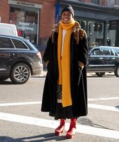 scarf,red boots,platform boots,ankle boots,maxi skirt,black and white,black coat,long coat,white sweater